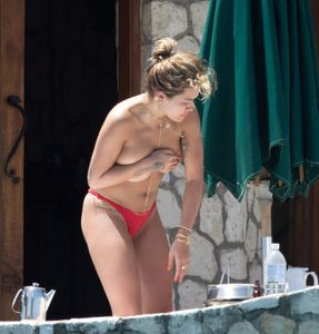 Rita-Ora-Topless-%28Covered%29-In-Jamaica-w7b8lqrm6k.jpg